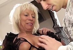 Mature woman fucks like crazy with a handsome young man, natural fucker