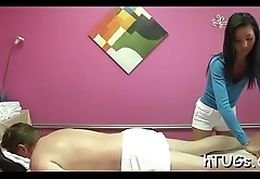 Asian hottie in the matter of gentle hands gives lucky guy a moist hot rub