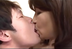 Beautiful asian mature plays with water on her moist pussy