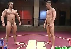 Inked wrestler deepthroating studs cock