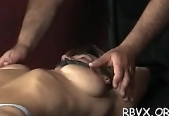 Breasty chick gets her tits thonged tight as she gets aroused
