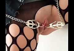 Slave A (Nov 2015) - Young European female slave suspended by the door in stockings and high heels only, tied tits, pussy clamps, pussy and breasts whipped harshly