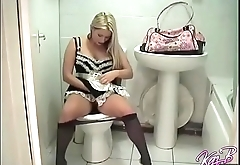 Merry blonde KazBxxx in maid uniform putting on a tampon