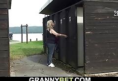 Blonde granny rides stranger'_s cock on public