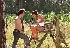 teen couple just 18 years outdoor in the deep grass