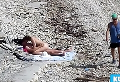 Couple fucked on a public beach while as kinfolk walked near