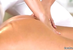 Blonde lesbians fingering in massage room